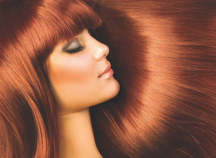 extremely beautiful woman with copper hair, pony, gray eye shadow