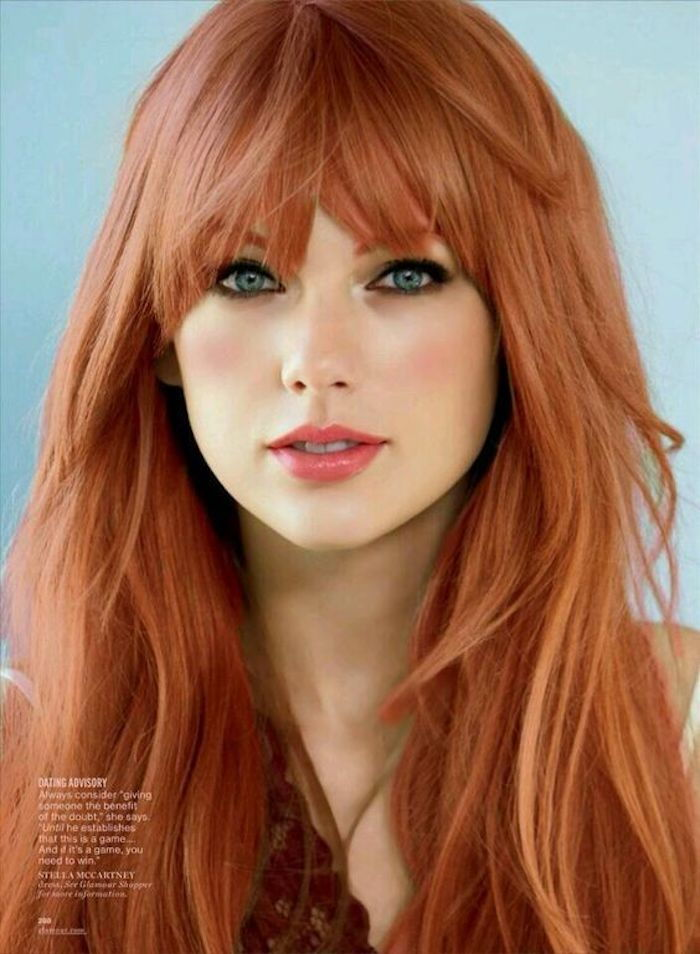 Taylor Swift with long hair and fringe, red hair, blue-gray eyes
