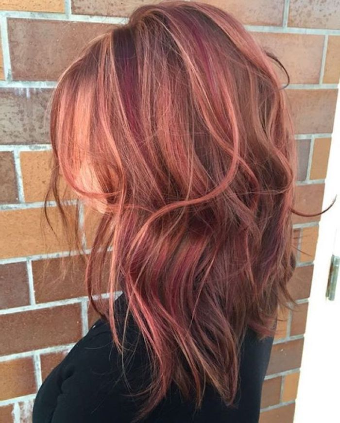 medium length hair in reddish nuances mixed with copper and purple