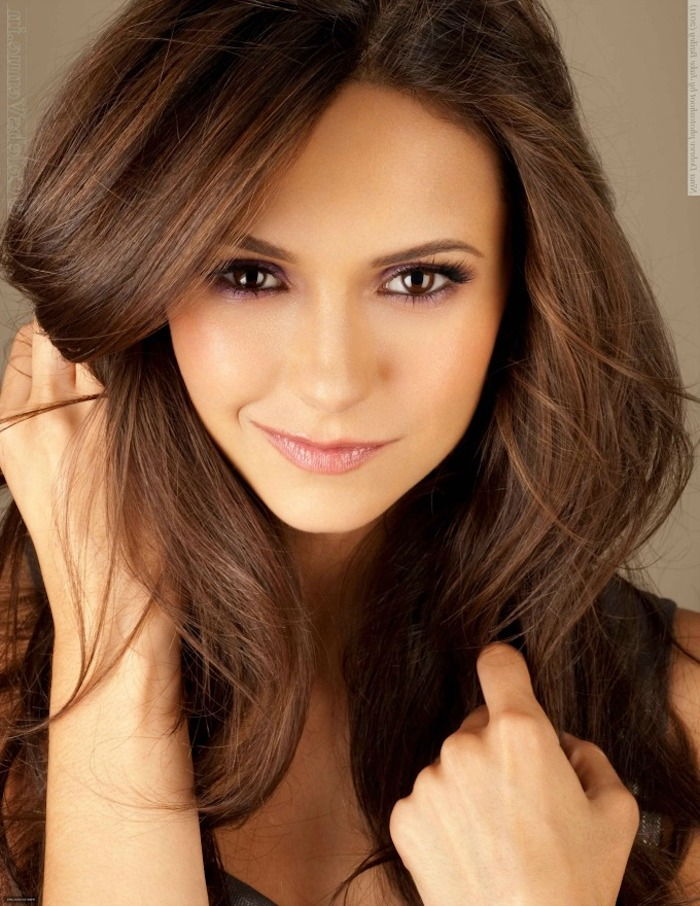 Nina Dobrev with chocolate hair, yellow complexion, long free-falling hair +