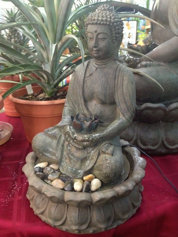 Buddha fountain-by-a-pot-plant