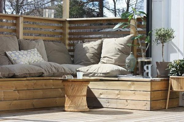 Corner bench for balcony made of wood with cushions