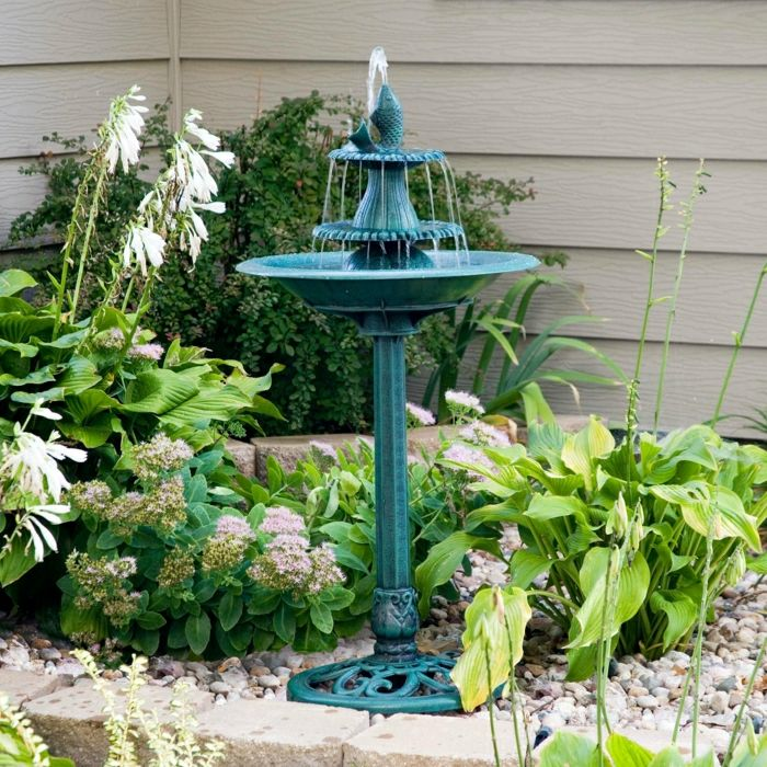 Garden Backyard turquoise water fountain Fish Flower Plants decorative stones