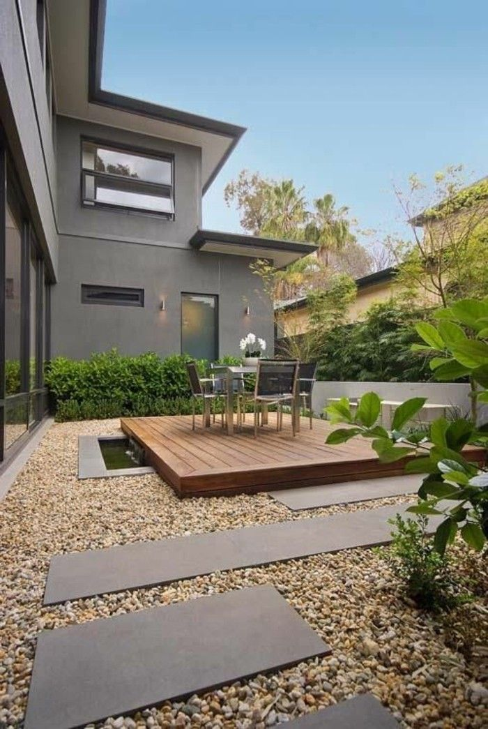 Garden design-with-stones-wood-and-dining table