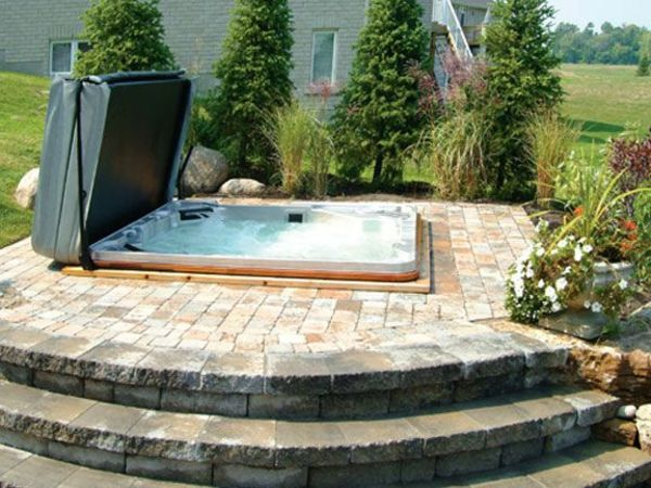 Modern-garden-with-a-jacuzzi-framing-whirlpool in the garden