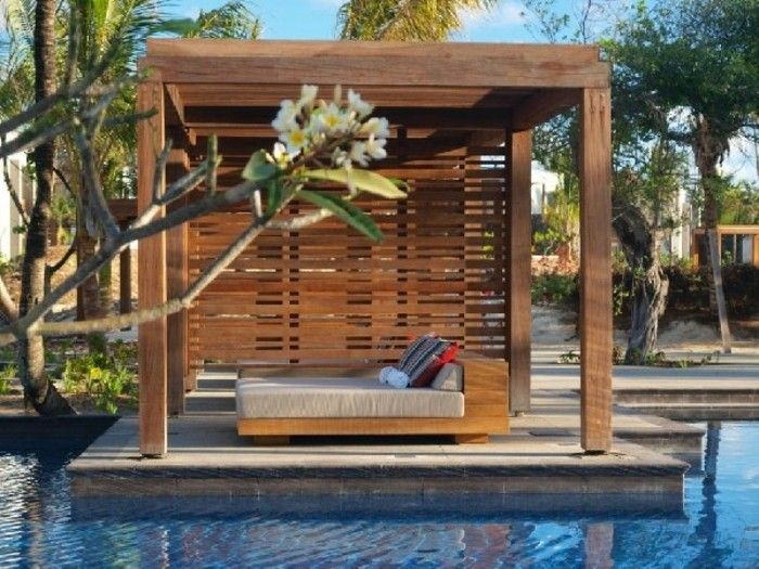 attractive design-of-pergola-of-wood-by-a-chic-pool