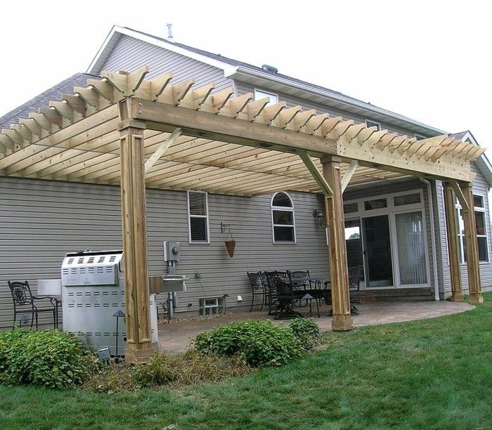 attractive-model-pergola-of-wood-green-grass-beautiful-house