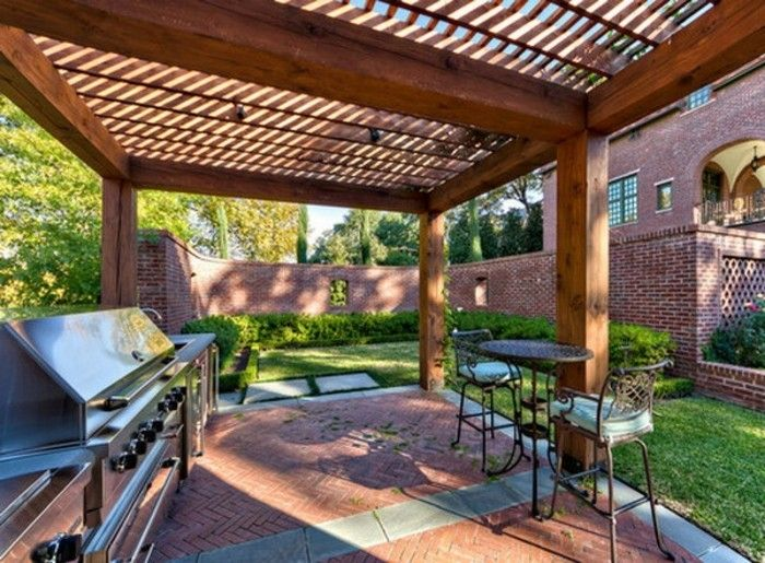 outside space-designed very-modern-with-pergola-of-wood-