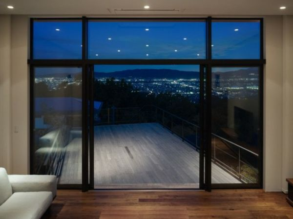 Balcony-out-of-the-wood luxurious glass wall and beautiful view
