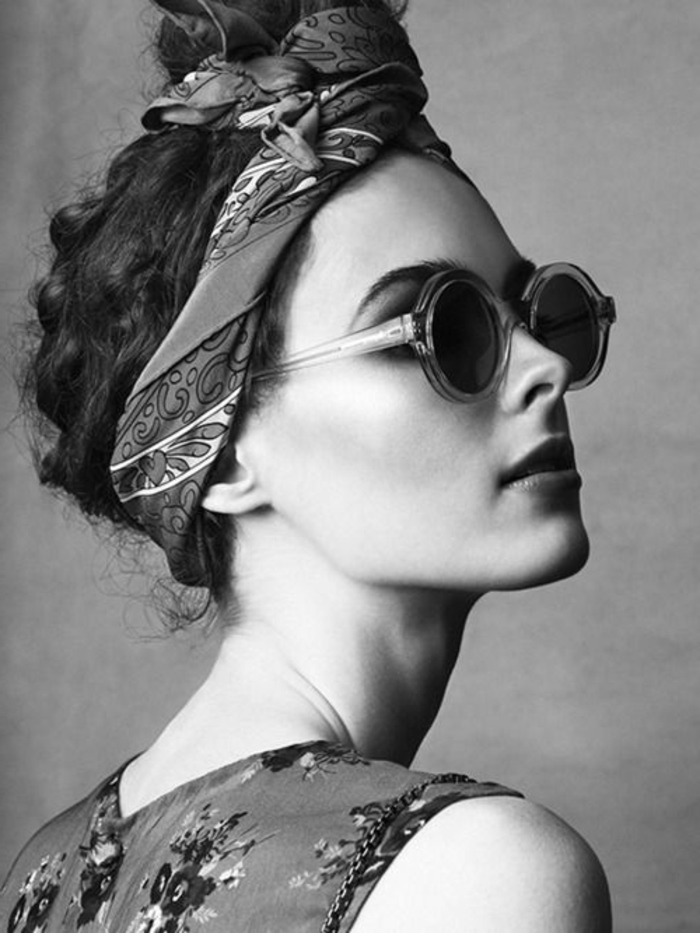 Woman with updo with bandana, dress with flowers and round sunglasses