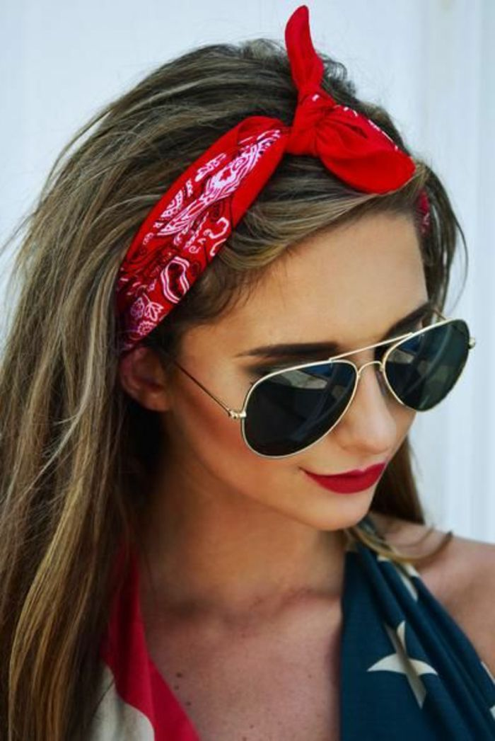 red bandana with white pattern, brown hair, sunglasses