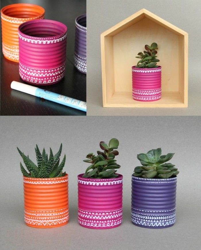 tinker-with-tin cans-wood-flower pot-in-different-colors-green-plant