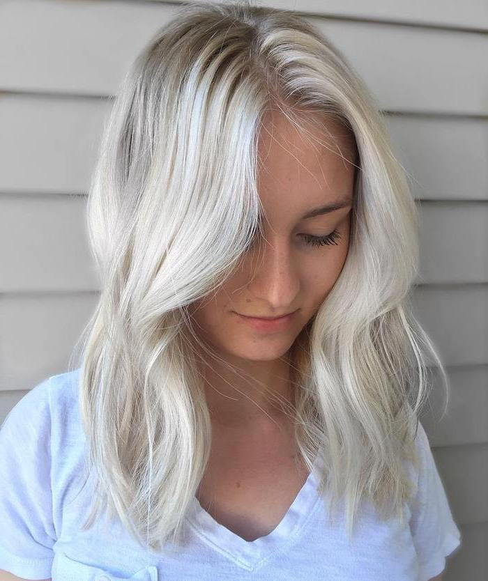 Hair color silver blond - a light shade of a young girl with a white blouse