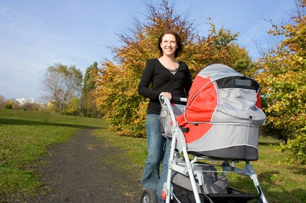 just-looking-woman-makes-walk-in-the-pure-nature-with-a-pram