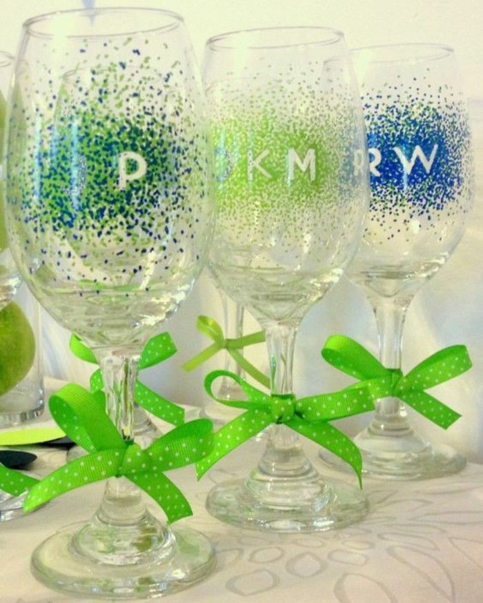 freshly-painted champagne glasses-decorated-with-ribbons