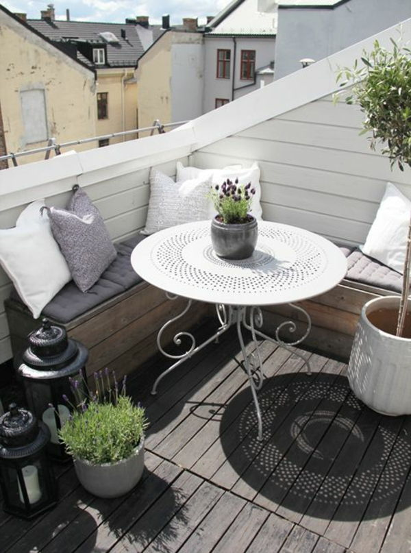 cozy balcony-with-corner seat and a round-table