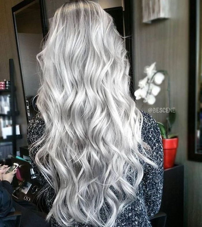 Blonde hair dyed gray - a long hair with loose curls and a gray blouse