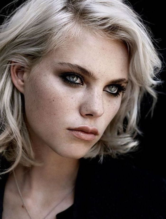 a beautiful girl with short curly hair and blue eyes - blonde hair dyed gray