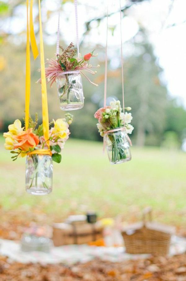hanging-glasses-with-flowers-as-decoration-for-the-garden party