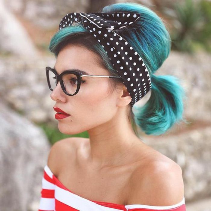 Lady with glasses, short blue hair and striped blouse