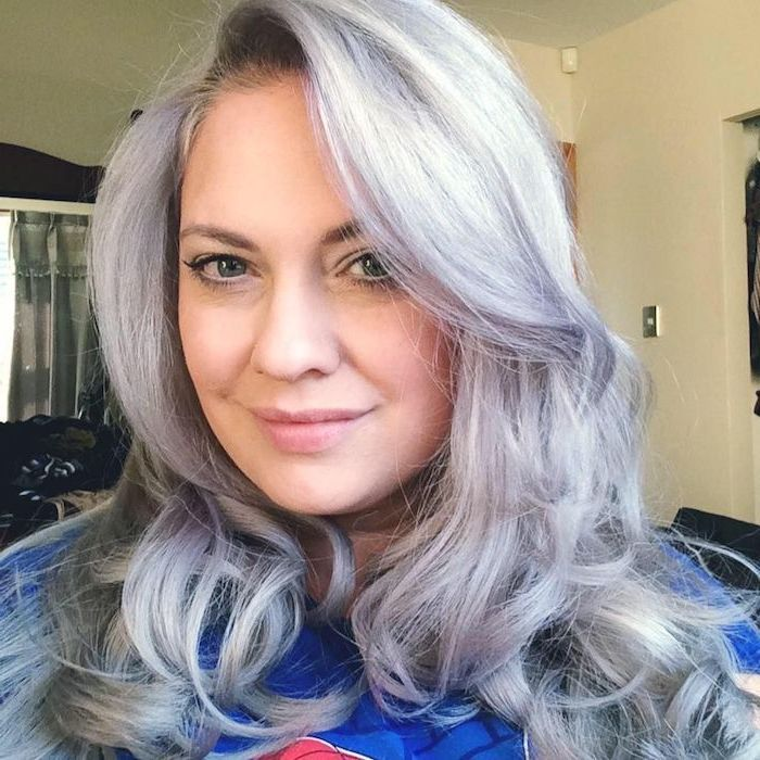 Silver-blonde hair - a woman with long curly hair who has already dyed
