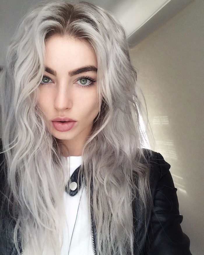 long curly hair of a girl with leather jacket and white blouse - silver blonde hair