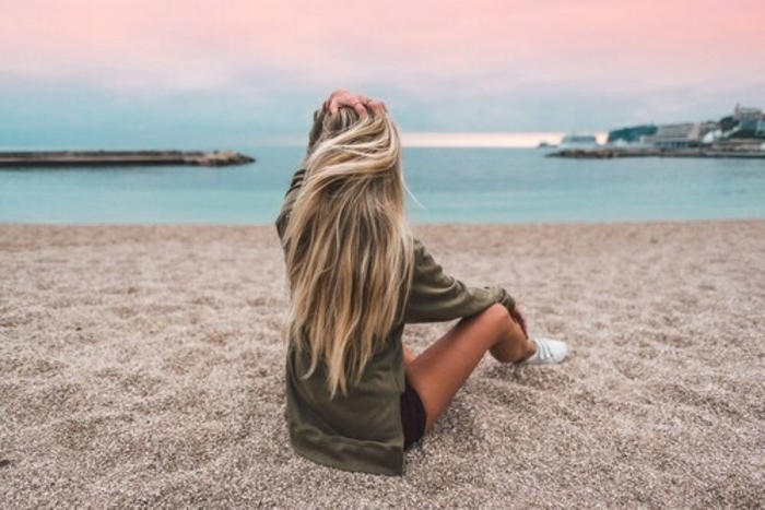 long hair with ombre hairstyle on the beach sea ocean atmosphere. Great photo
