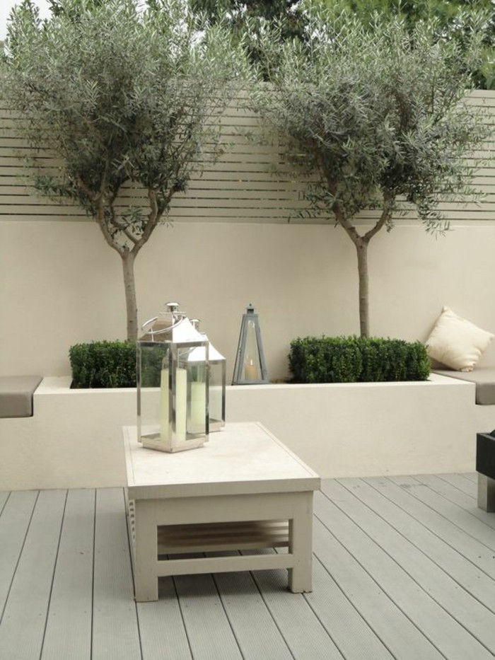 modern-gartengestaltung-planting-modern-garden table and-deco-with-candlestick