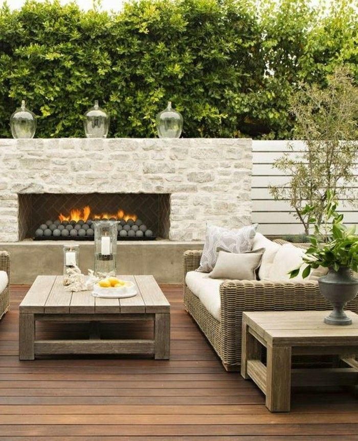 modern-gartengestaltung-with-face protection-fireplace-rattan lounge furniture and-coffee table-of-wood