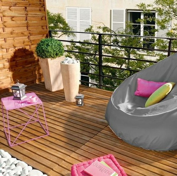modern-terrace-design-made of wooden armchair with throw pillow