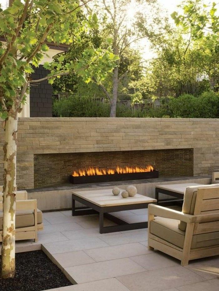 modern-brick-fireplace-garden design-with-lounge furniture