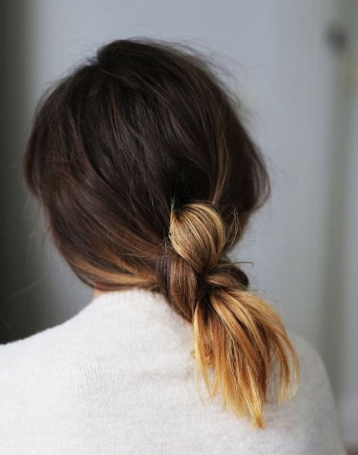 tying brown hair with blond tips to create a unique and simple hairstyle
