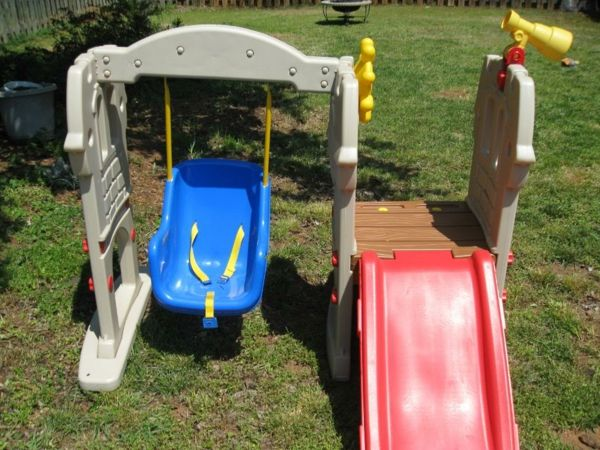 red-slide-and-blue-swing-from-plastic-garden-design-ideas-playground