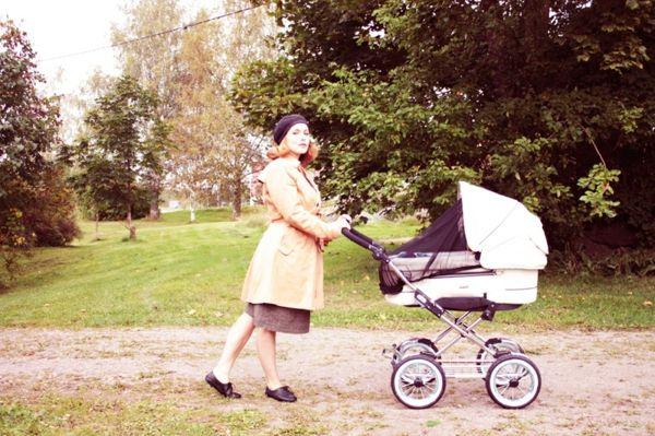 beautiful-woman-with-stroller-makes-walk-in-the-pure-natural