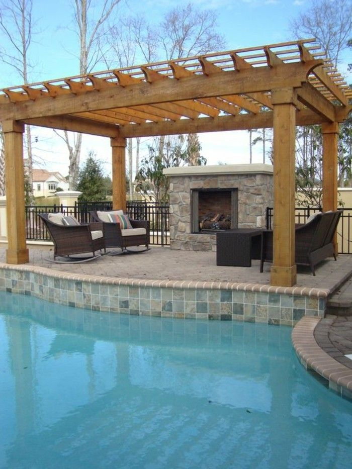 swimming pool-garden-with-brick-fireplace-pergola-and-rattan lounge-furniture in