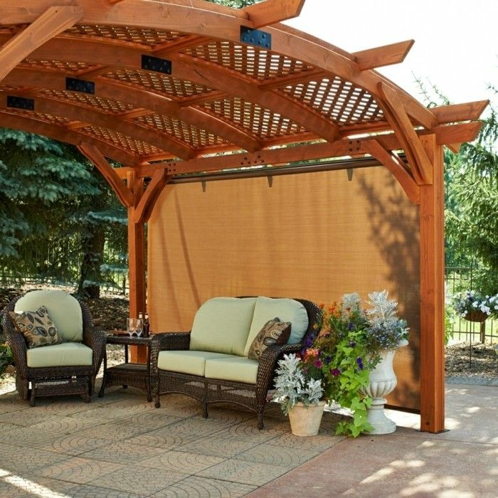 orange curtains and pergola of wood in the beautiful garden
