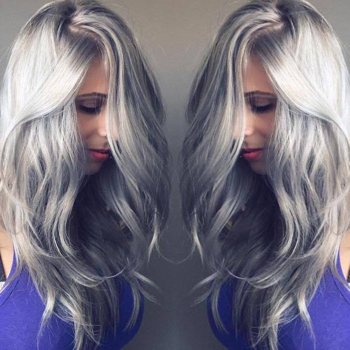 Silver blonde hair of a cute girl, as she looks from two corners