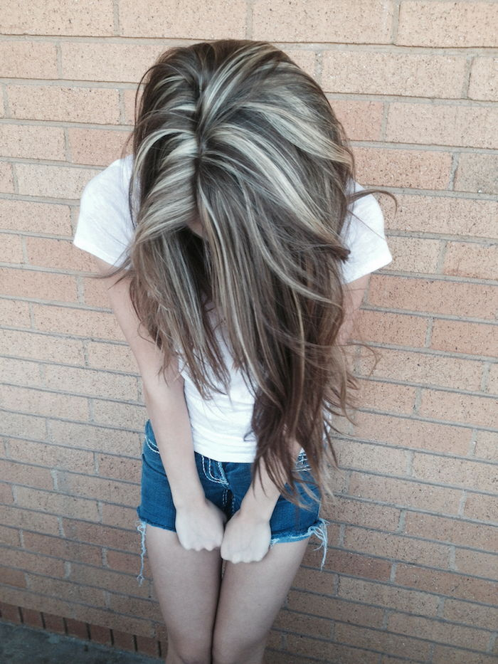 silver blonde hair - a girl shows her hair, which is provided with silver-blonde highlights