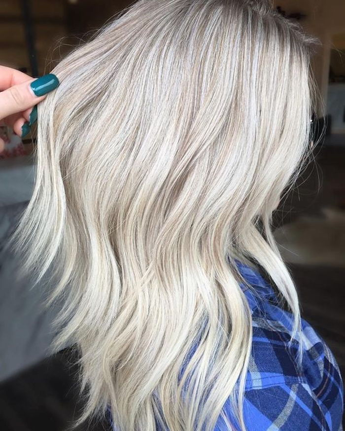 Hair gray tones - a woman with a blue shirt and bright silver hair