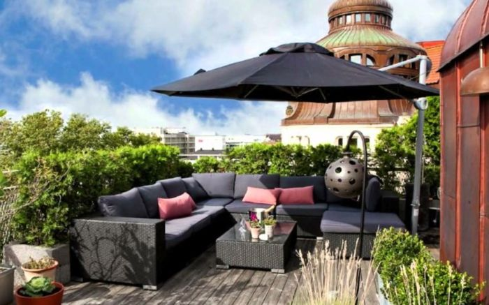 terrace design ideas pictures beautiful small terrace in the city big sofa with umbrella and pillows