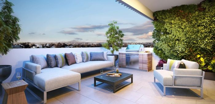 elegant and understated terrace with large sofa create a colorful sofa cushion green plants
