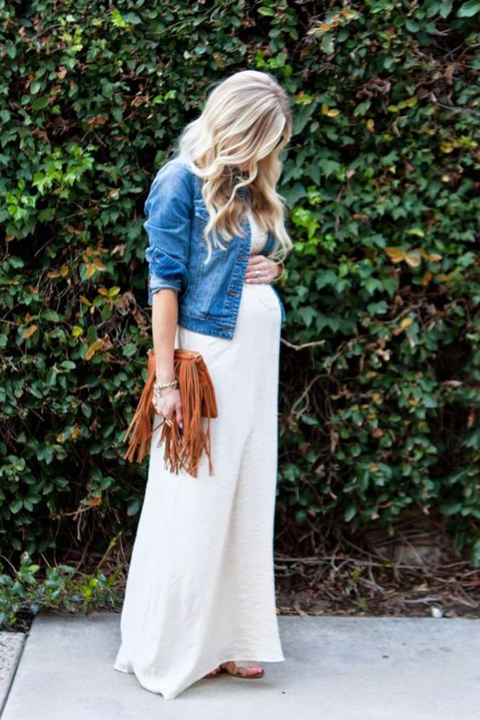 Maternity dress in white, denim jacket, brown leather bag