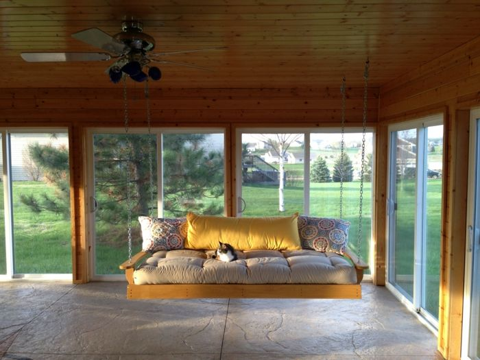 porch-swing-glass-walls-covered-space