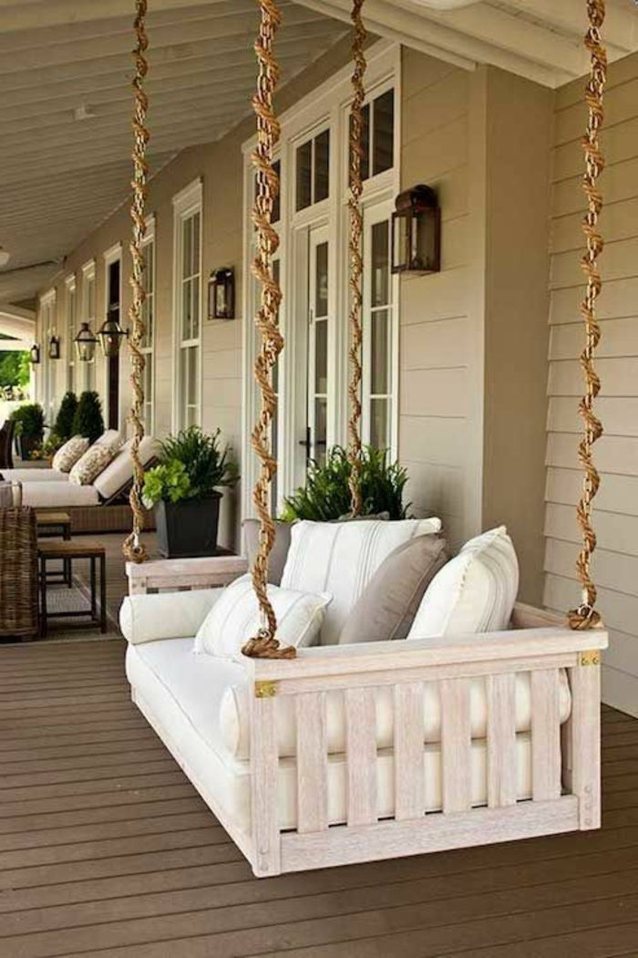 porch-swing-with-big-white pillows