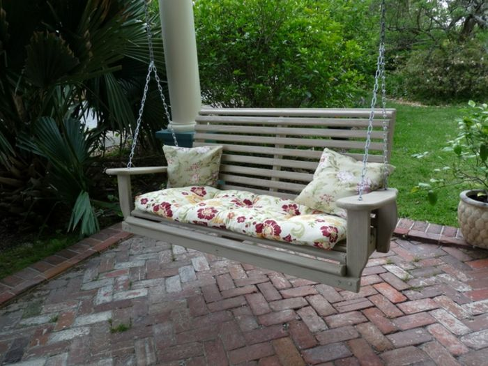 porch-rocking-two-gray decorative pillows