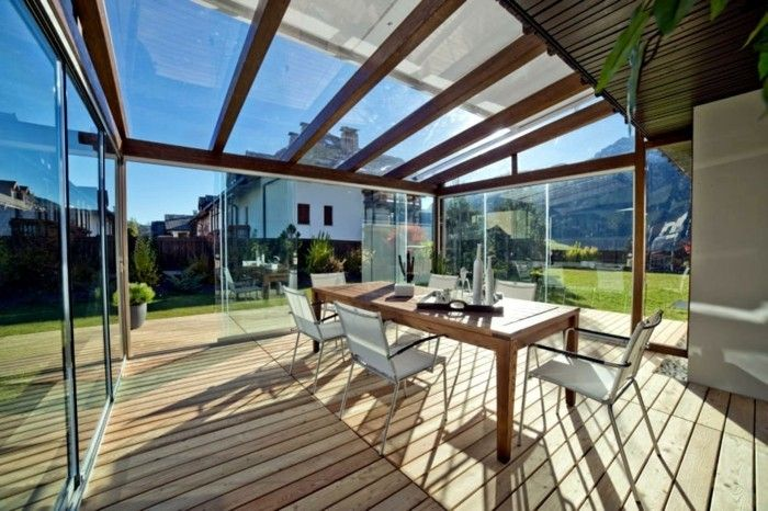veranda glazing-wood-flooring-and-large-wood-table-with-seating