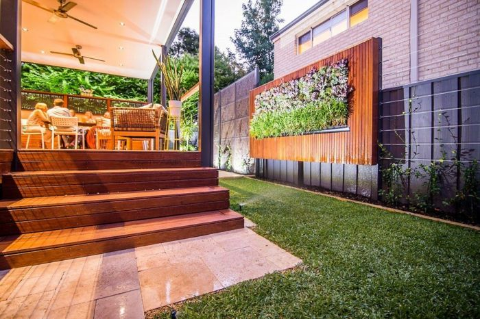a modern house with vertical planting as a mural in the garden
