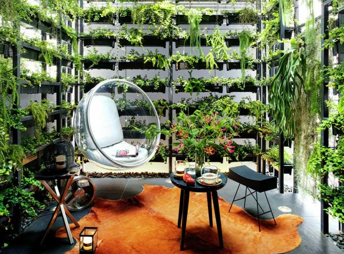 modern swing in the living room surrounded by vertical planting