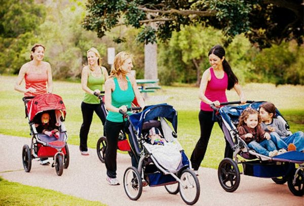 many-mothers-run-together-in-park-with-their-small-children-in-stroller