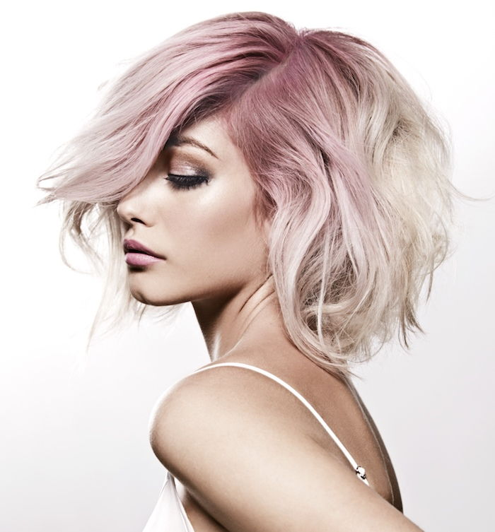short blond hair with a pink neck, pink-brown skin, top with straps